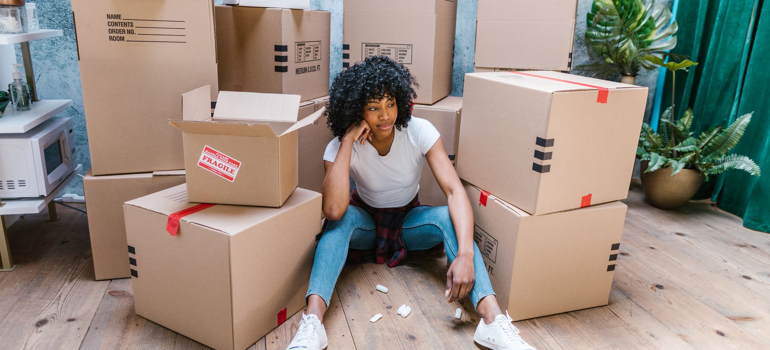 Girl surrounded with boxes