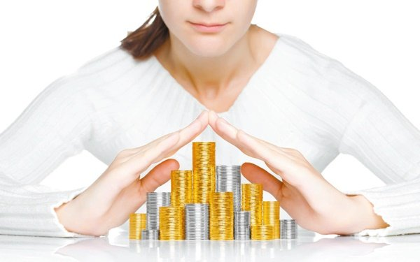 Woman stacking coins, moving company, how much money will my move cost