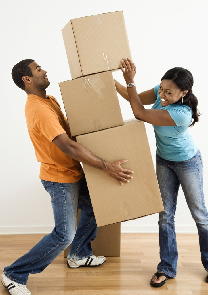 Couple with moving boxes. Moving company, U. Santini moving and storage, Brooklyn movers