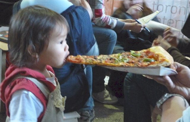 Girl eatting pizza, moving day food, moving company, U. Santini moving and storage