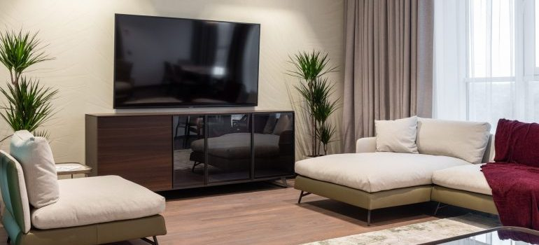 A flat screen TV on the living room's wall