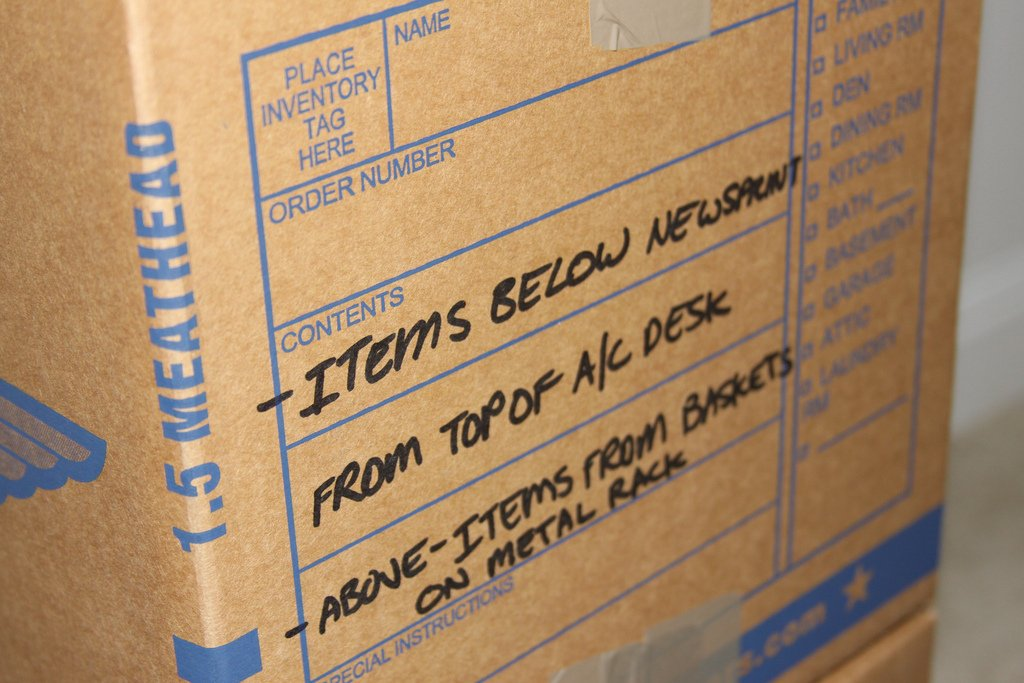 Label boxes, moving, moving company, U. Santini moving and storage