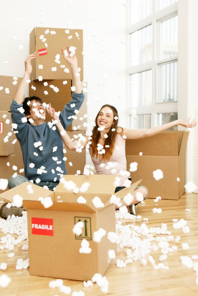 People throwing packing chips, unpacking, moving company, U.Santini moving and storage, Brooklyn mover