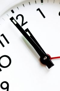 clock face representing that timing is important when packing your pantry