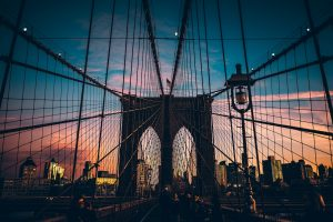By walking on the Brooklyn Bridge you can see astonishing sunset