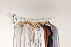 assorted clothes on wooden hangers