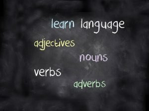A blackboard with the following words written on it - learn, language, adjectives, nouns, verbs, adverbs.