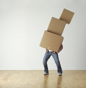 man holding boxes - Flatbush Movers