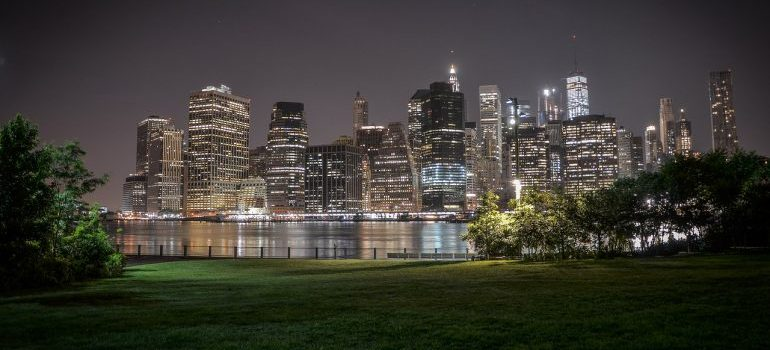 Brooklyn bridge park during the night with a view on the city.