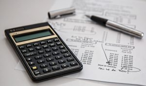 calculator, paper and pen as a perso need to do before transfer utilities when moving