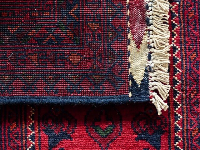 How to pack and move large area rugs