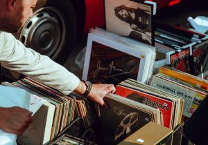 A man looking through vinyl records on a yard sale