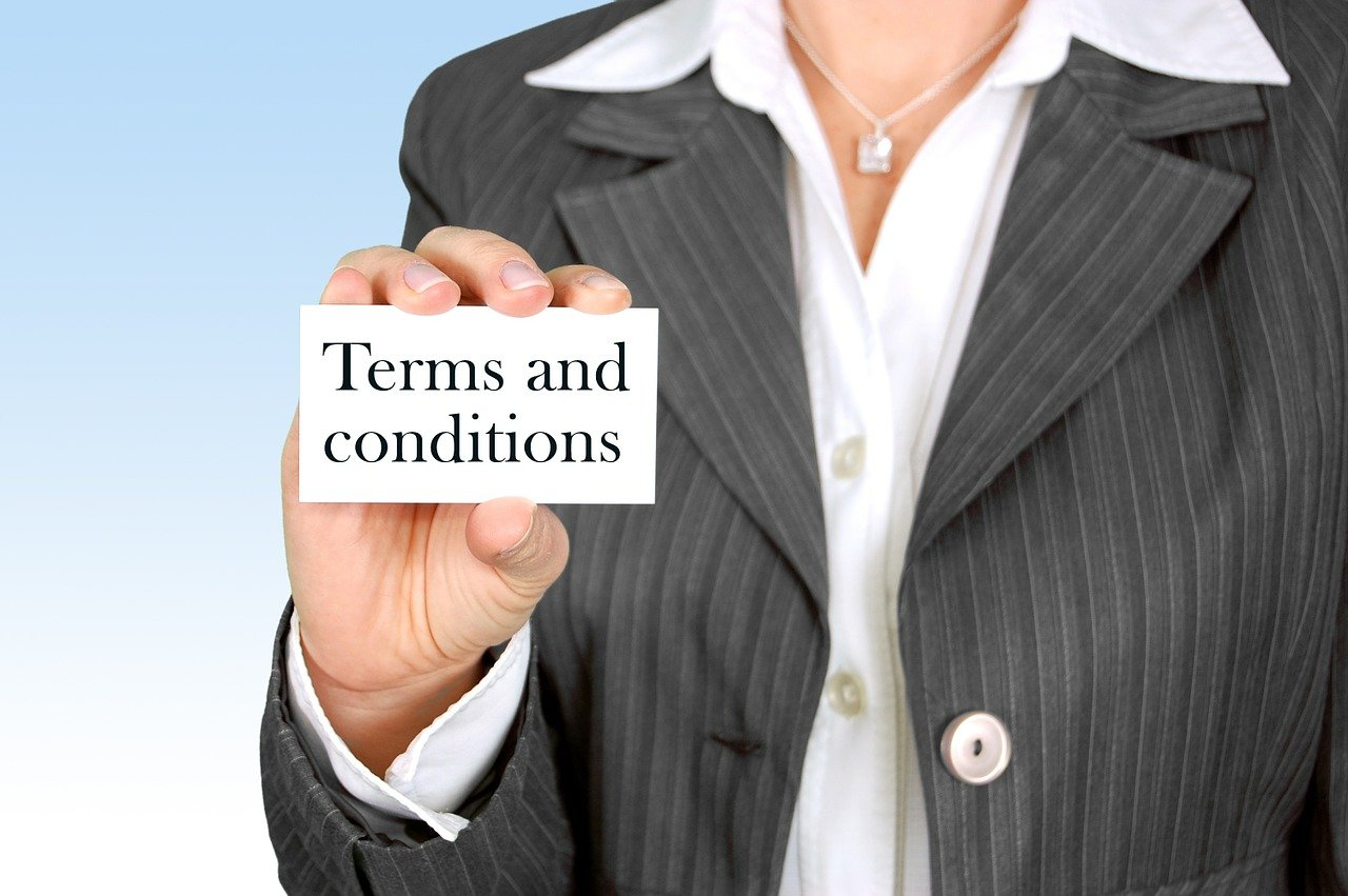 ta women holding terms and conditions sign