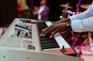 A man playing electric keyboard