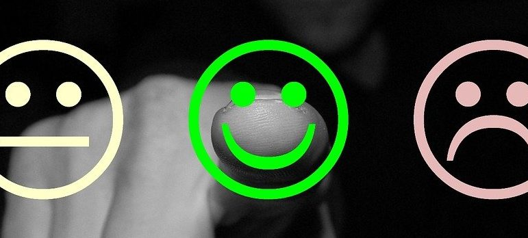 A man pointing at the smiley face