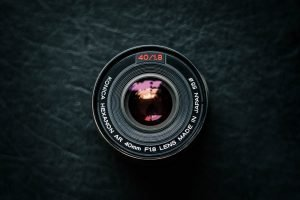 Camera lens on a black surface