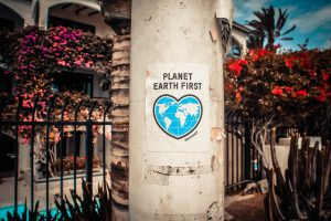 sign saying planet eart first as part of green moving