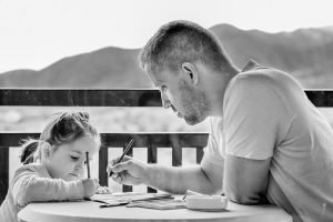 father drawing with his daughter