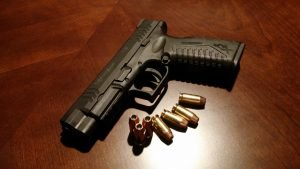 A handgun and some bullets, all forbidden items in a storage facility.