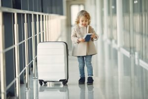 girl with a suitcase and a passport