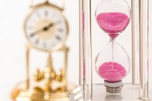 An hourglass and a clock