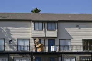 A terrace with moving boxes that you won`t have to buy with a full service moving company.