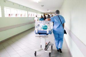 nurse pushing cart