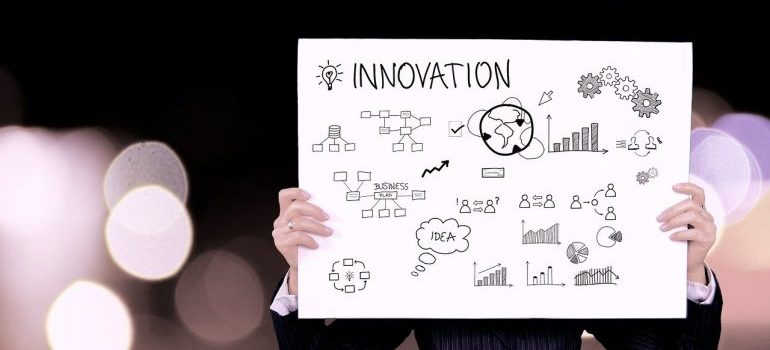 a business person holding innovation banner