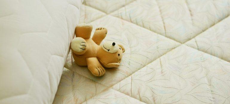 A mattress and a teddy bear