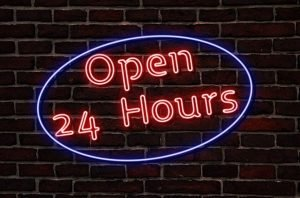 An open 24 hours neon sign.