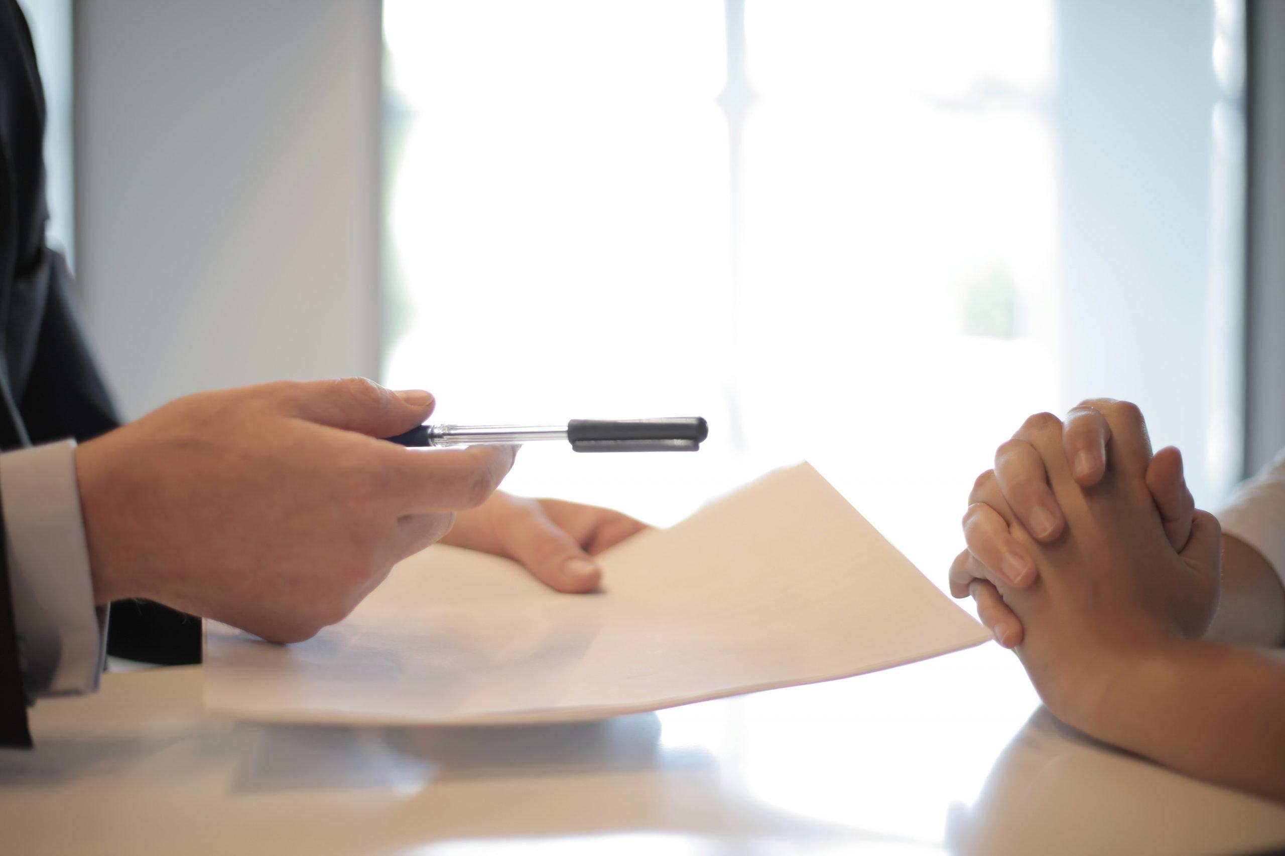 contract pen, pair of hands