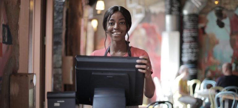 A girl at the cash register