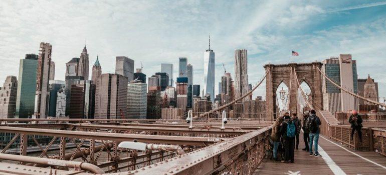 People standing on the Brooklyn bridge.