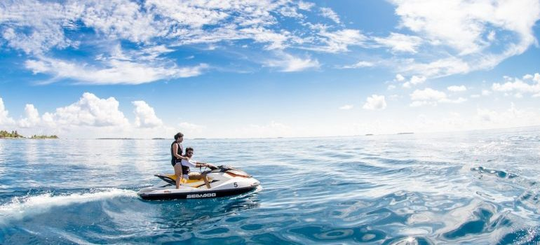 People in the sea on the jet-ski.