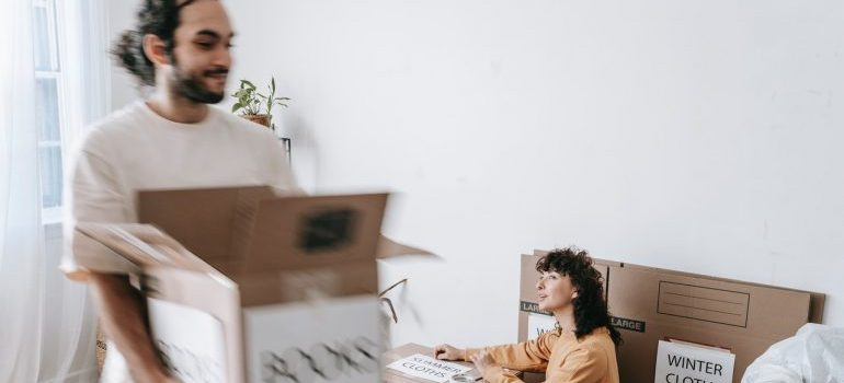 Two people packing and preparing for a move.