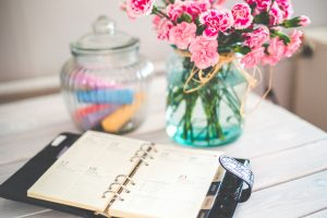 planner and flowers on the table