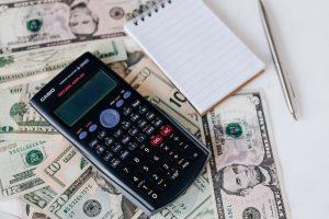 Dollar bills next to a calculator