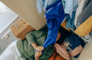 girl on a floor with clothes