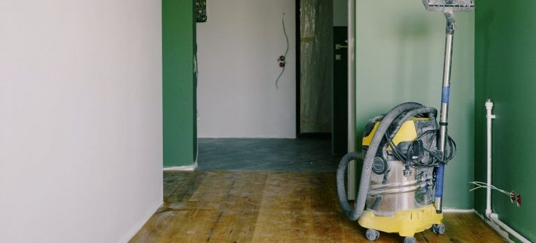 Vacuum cleaner inside an empty apartment.