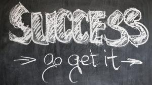 A blackboard with the words `success go get it` written on it.