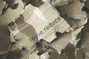 sign on cardboard reduce reuse