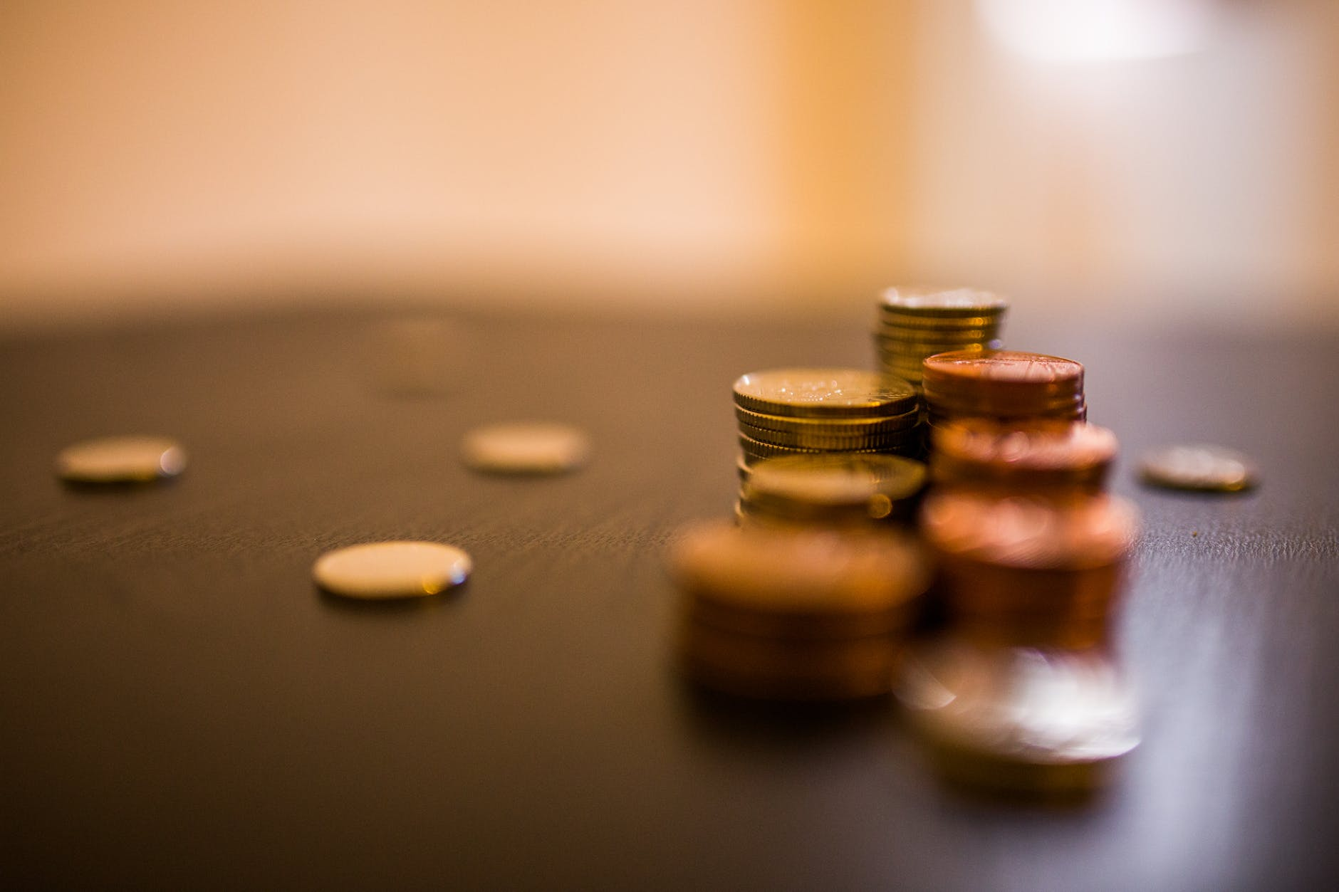 A few stacks of coins on the table. If you negotiate your rent, you will save more than a few coins.