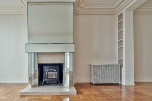 An empty room containing only a fireplace.