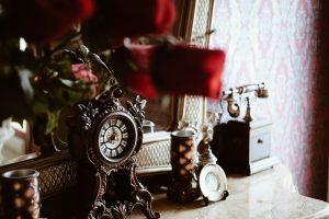 antique watch, phone on a shelf
