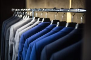 A row of different colored suits.