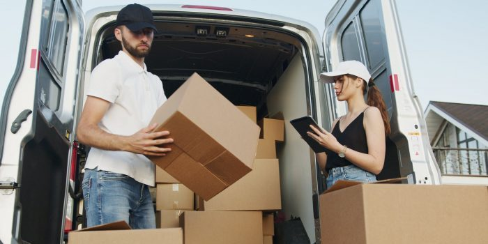 A couple loading a moving truck