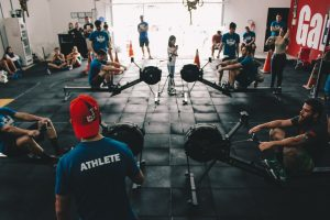 A gym packed with people and equipment.