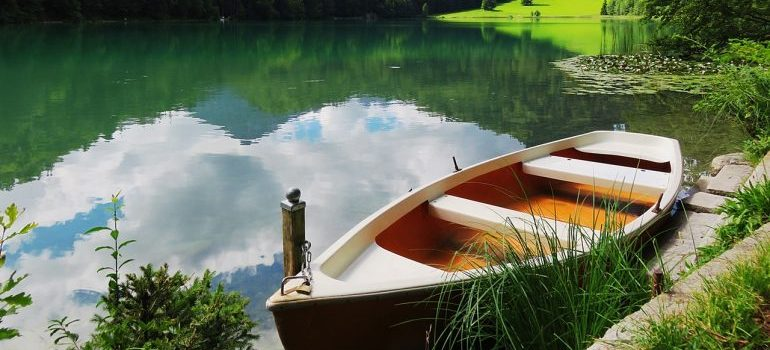 Wooden small boat in the lake.