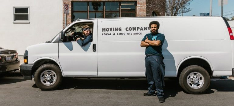 Two movers and their van for moving.