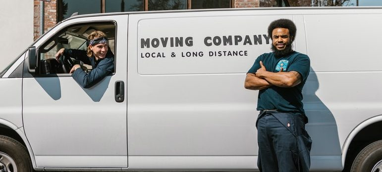 Movers next to a moving vehicle